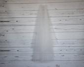 Ivory simple cut edge, 2 tier veil, your choice of length