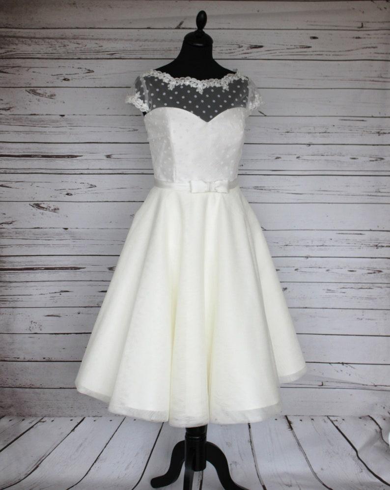 Ivory polka dot and tulle tea length 50s style wedding dress image 0