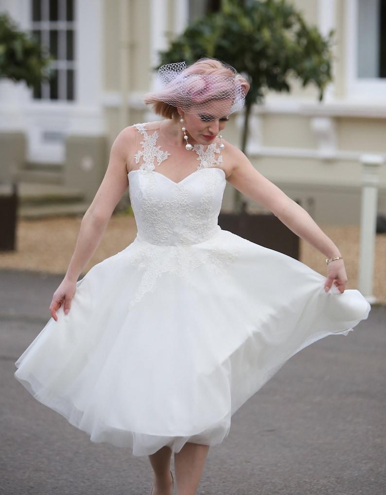 Ivory illusion lace tea length 50s style wedding dress image 0