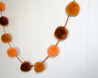 Pom Pom Garland Orange and Rust (9)  2 inch Pom Poms    Pom Pom Banner * Party Pom Pom Garland * Nursery Garland * Photo Prop Garland