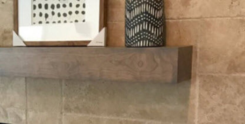 Light grey cherry wood beam mantel.