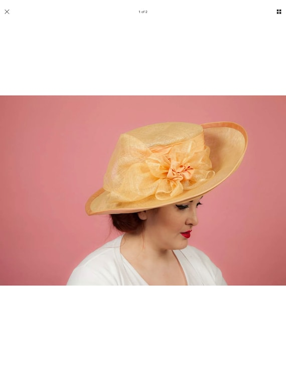 Oversized peach apricot coloured formal hat