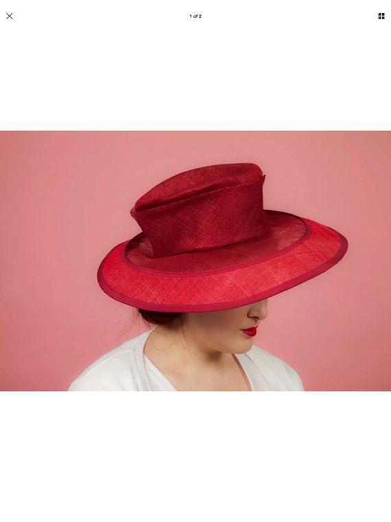 Large red formal hat