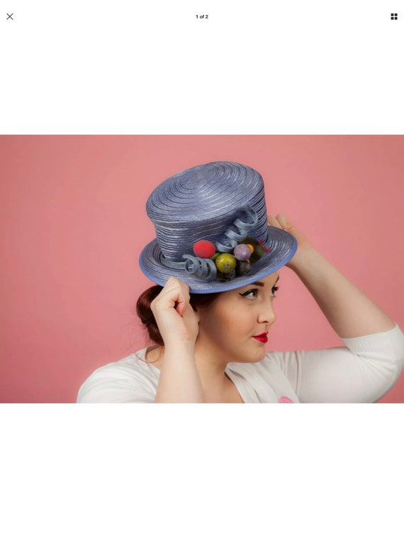 Blue formal hat with fruity twist