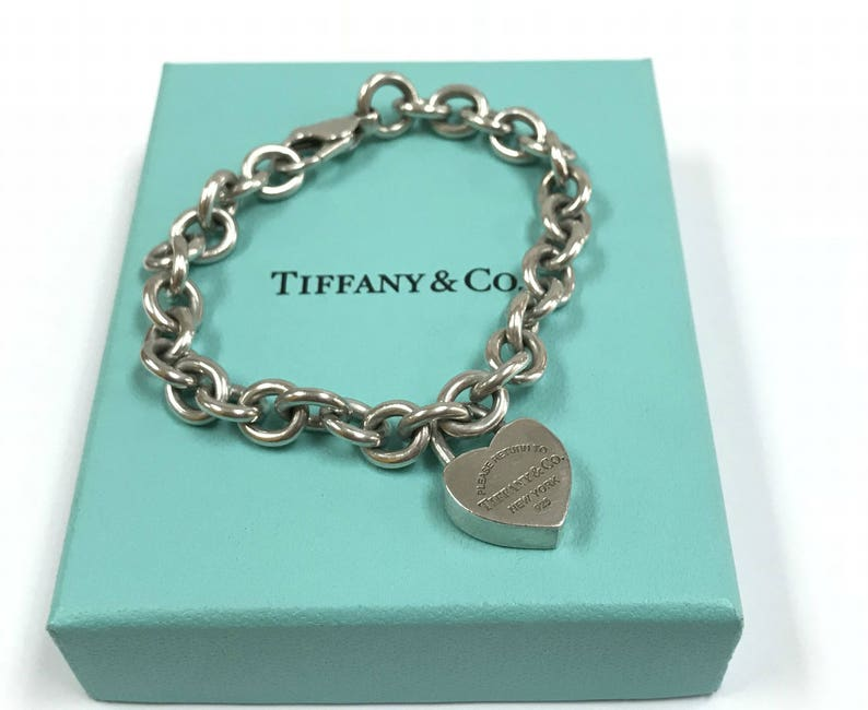 4b64a880f09 Authentic Please Return To Tiffany   Co. New York