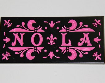 Custom Carved Black and Pink New Orleans Sign