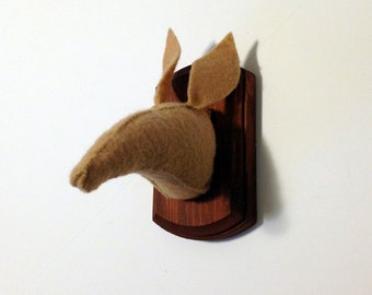 Aardvark faux taxidermy on wooden mount