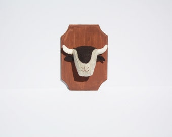 Bison faux taxidermy on wooden mount