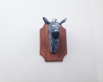 Zebra faux taxidermy on wooden mount
