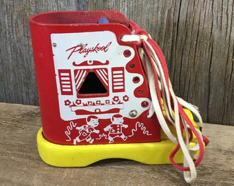 Vintage Playskool lace up boot, vintage toys, vintage toy decor, bright colored toy decor, Playskool collector, Playskool lace up shoe