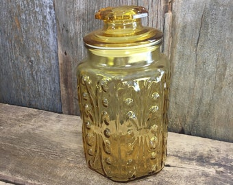 Vintage amber glass canister with an Atterbury scroll design, beautiful amber gold color decor, vintage glass, vintage container, vintage