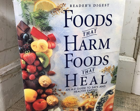 Readers Digest Foods That Harm Foods That Heal copyright 1997, large hard cover with dust jacket, An A-Z guide to safe and healthy eating