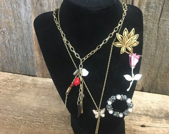 Vintage lot of Avon jewelry, five pieces of Avon jewelry two necklaces and three brooches, vintage Avon jewelry, beautiful Avon pieces