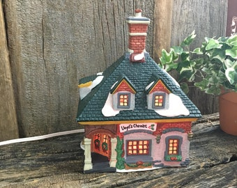 Dickens Collectable lighted Christmas house, Lloyd Chemist Dickens collectable house, porcelain lighted Holiday House, lighted house