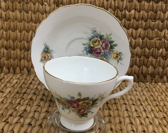 Beautiful Sovereign House Exclusive tea cup and saucer, Sovereign House Fine Bone China made in England Rose Tea cup and saucer, Roses cup