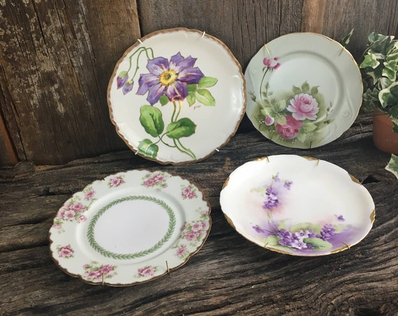 Vintage lot of four collectors plates, vintage Limoges plates, Lefton China plate, Rosenthale plate, Blakeman and Henderson plate