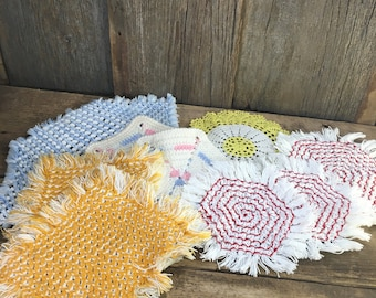 Vintage mid century lot of pot holders and doilies, mixed lot of mid century decor, kitchen and living room decor, multi color lot