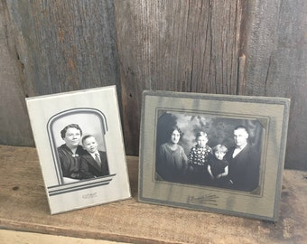 Pair of early century family photos, early paper, black and white family photos, vintage family photos in cardboard frames, vintage frames