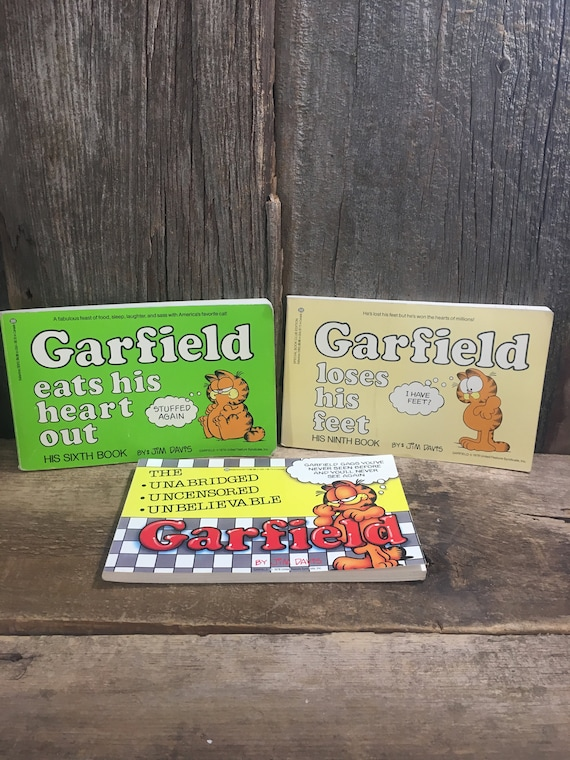Lot of three vintage Garfield books, Garfield loses his feet, Garfield the unabridged uncensored unbelievable, Garfield eats his heart out