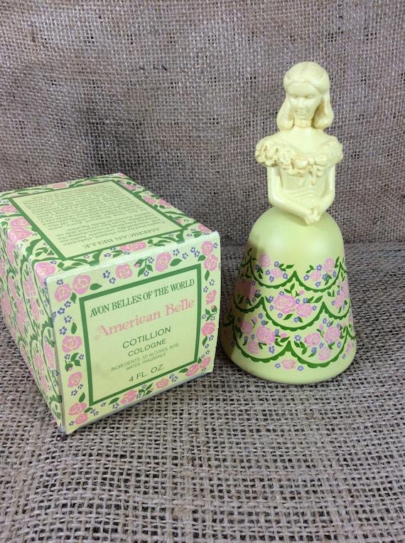 Avon collectibles, Avon Belles of the world, Cotillion cologne, American Belle Avon collectible, Yellow Avon collectible, Yellow figurine