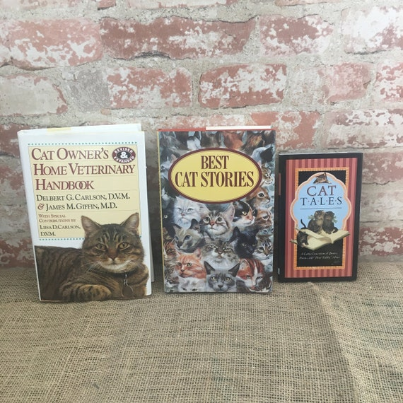 Wonderful lot of three vintage Cat books, Cat Owner's Vet handbook, Best Cat Stories, Cat Tales, Cat books from the 90's great condition