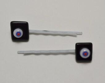 Black and millefiori Bobby pins.