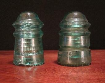 Two Antique Hemingray Green Glass Electrical Insulators