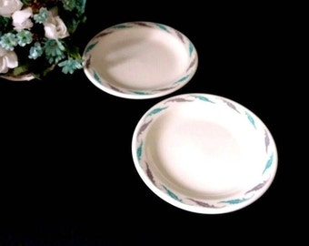 Homer Laughlin dessert plates, set of 2, made for Edward DON & Company, 1950s, feather/leaf design, white plates
