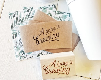 A Baby Is Brewing. Coffee Cup Sleeve Stamp. Custom Coffee Sleeves. To Go cup Sleeves. Custom Baby Shower Stamp. Baby Shower Decor.