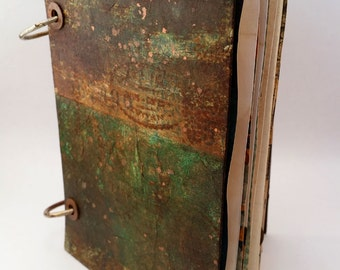 Grunge journal with tags, pockets and paperclips