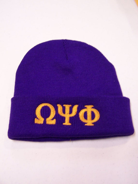 OMEGA PSI PHI Deep Purple Embroidered Greek Letter Monogrammed Acrylic Knit Beanie/Que Dawg Beanie/Purple w Gold Embroidered Beanie