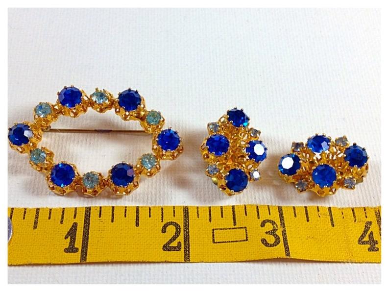Vintage Austria Aquamarine and Cobalt Blue Crystal Set B 125 Blue Crystal Brooch and Clip on Earrings set in Gold tone metal