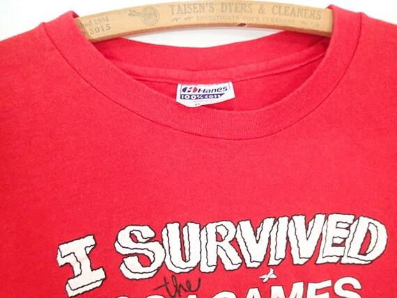 1664e1f0a93f 1984 Los Angeles Olympics HUMOR tshirt XL I Survived