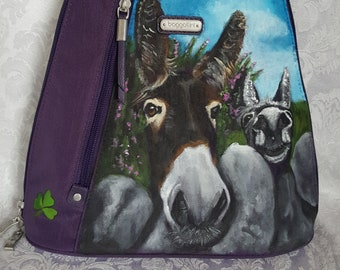 Handpainted Portrait of Donkeys Rose and Conor, Irish Donkeys on a Baggallini Purple Metro Backpack