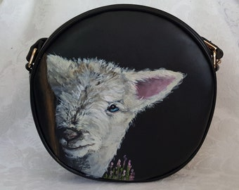Hand painted faux vegan leather crossbody purse hand painted with portrait of Meara, the lamb