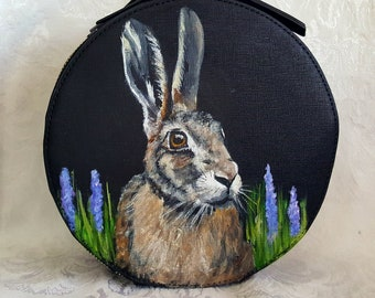 Hand painted portrait of Harriet the Hare on a Hudson + Bleeker Amora Nomad Round Travel Case