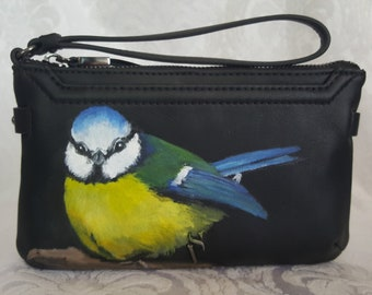 Simply Vera Wang Joyce Wristlet hand painted with a portrait of Hailey a Blue Tit also known as  Meantán gorm in Irish