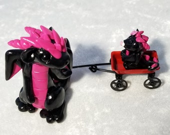 Pink and Black Mom and Baby in a Wagon Dragon Sculpture
