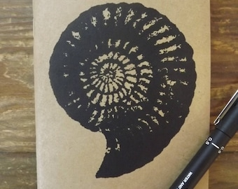 MADE TO ORDER - Screen Printed note book/ sketch book which features an Ammonite/Fossil - A6 Plain Paper, Eco -friendly
