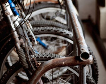Photograph of rusty beach bikes