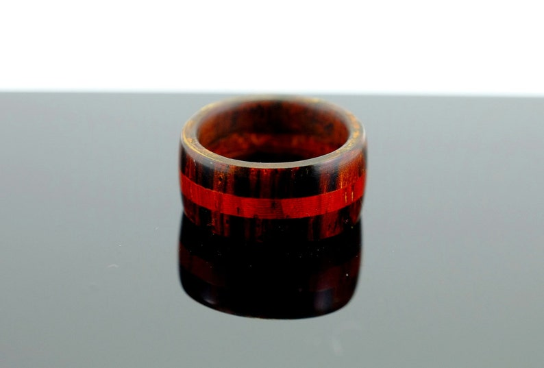 Brown and red wooden ring image 0
