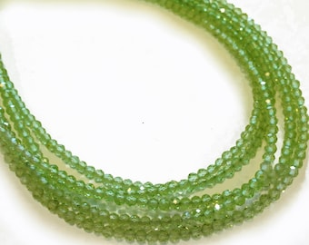 Peridot 2mm micro-faceted rondelles.   Select a strand length.