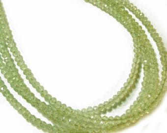 Prehnite 2.5mm micro-faceted rondelles.   Select a strand length.