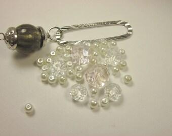 37 assorted 4-16 mm (ø31) glass beads