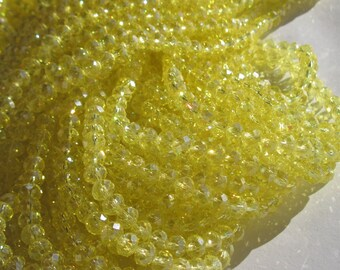 16 reflection (71) 10mm yellow faceted glass beads-