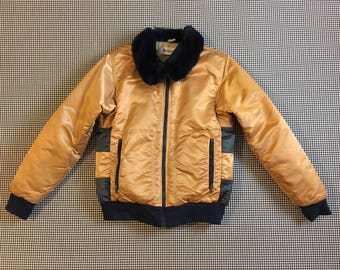 1980's, down filled, jacket, in gold with blue trim and circle design, Men's size Medium