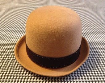 1960's, felted wool derby hat in tan, with dark brown, band and gold buckle, Adult size