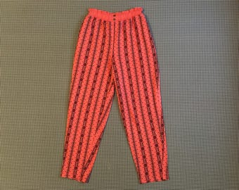 1990's, soft pants, in salmon, with abstract, tribal print, Women's size Medium/Large