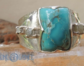 hand made silver ring with antique tibetian turquoise and row diamonds