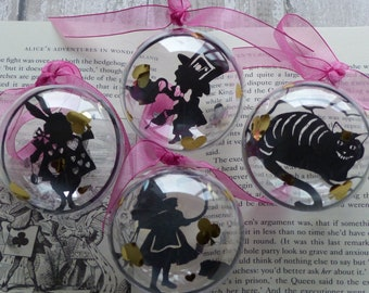 Quad of Alice in Wonder land paper cut silhouettes baubles The Cheshire Cat, Alice, The Mad Hatter & the White Rabbit